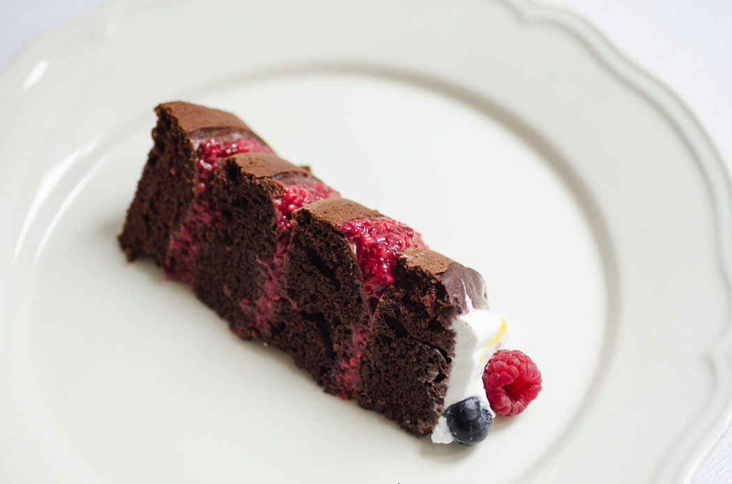 Chocolate layer cake with raspberry chia jam and coconut whipped cream