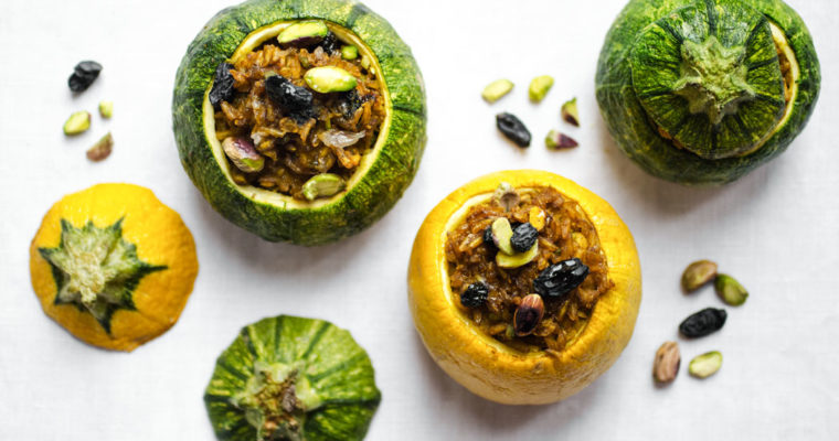 Round zucchini stuffed with spiced brown rice, raisins and pistachios // vegan