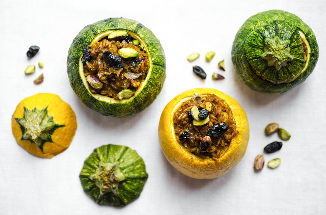 Round zucchini stuffed with sweet spiced brown rice, raisins and pistachios // vegan