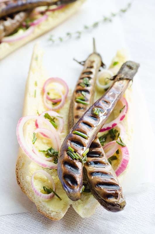 Chinese eggplant hot dogs with mustard mayo, herbed oil and quick pickled onions // vegan