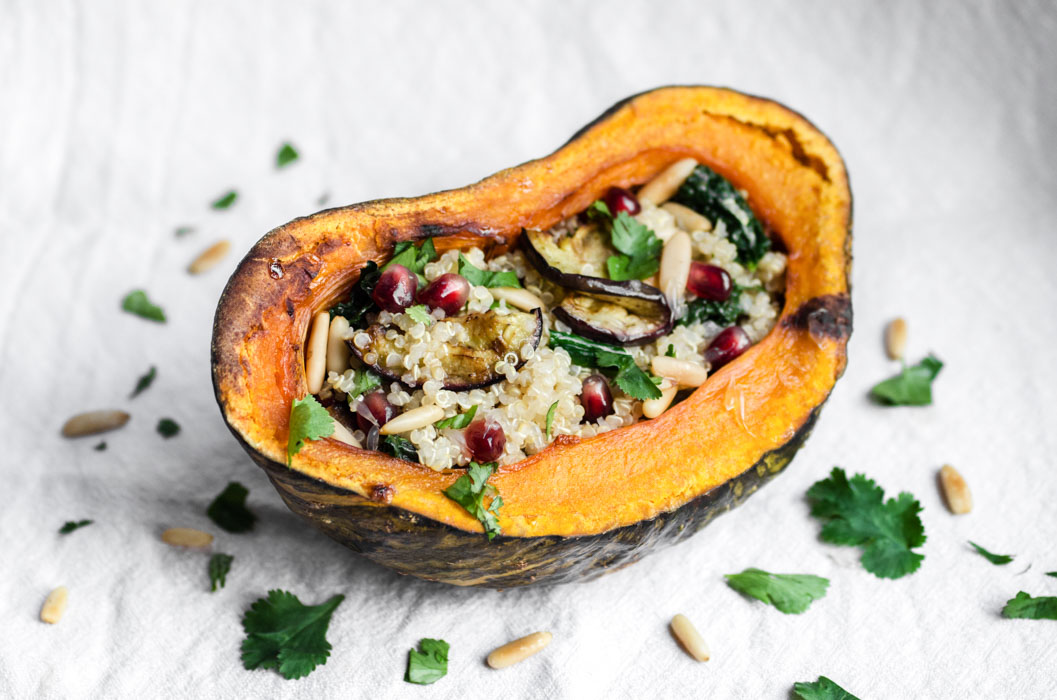 Baked kabocha stuffed with eggplant, cavolo nero and pomegranate quinoa salad // vegan