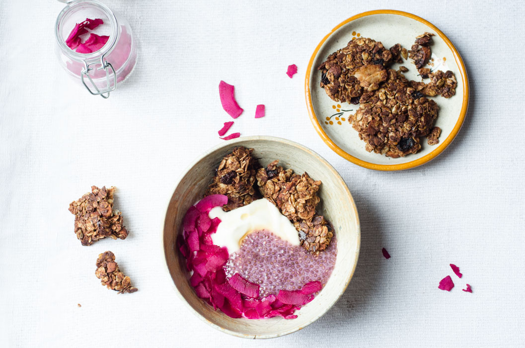 Breakfast bowl with chia pudding, pink coconut chips and granola clusters // vegan