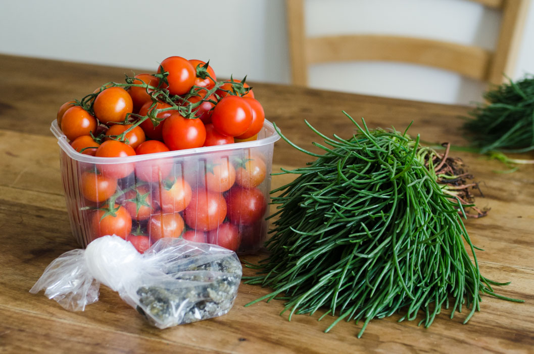 Agretti nest with pan-seared tomatoes on the vine