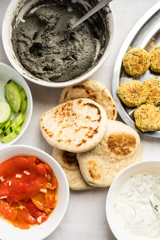 Homemade pita w/ baked falafels, black hummus, roasted peppers and more {vegan} - Marta's Plants